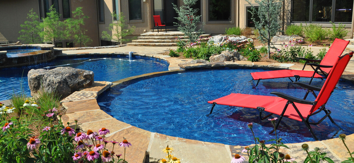 In-ground pool in backyard area.