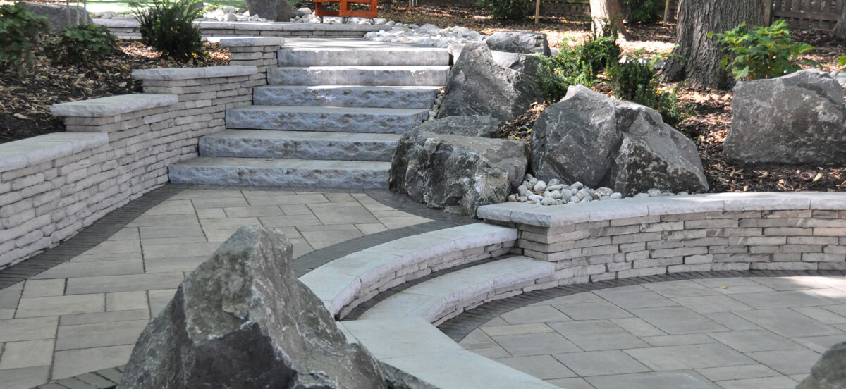 Stone steps in backyard area for residential landscape design.