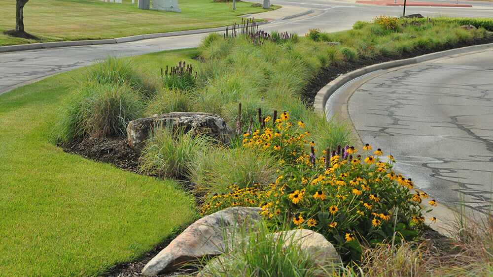 Landscape design near a roundabout completed by Embassy Landscape Group.