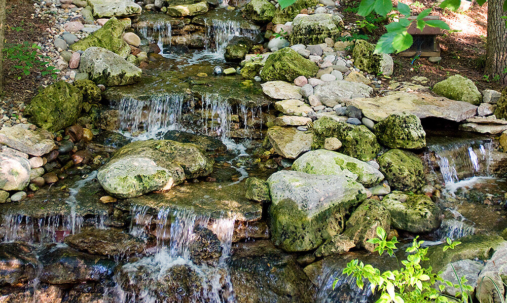 natural looking waterfall landscape design