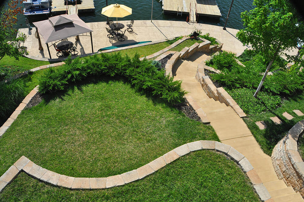 Aerial photo of backyard with stone pavers.