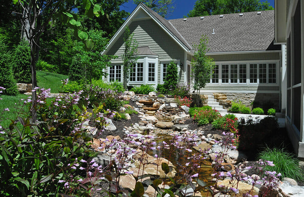 Backyard with pond and flowers.