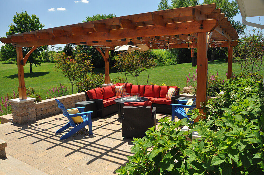 Backyard with pergola and seating area.