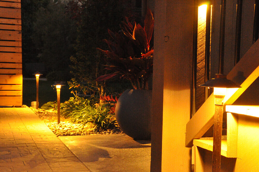 residential landscape design at night with outdoor lighting