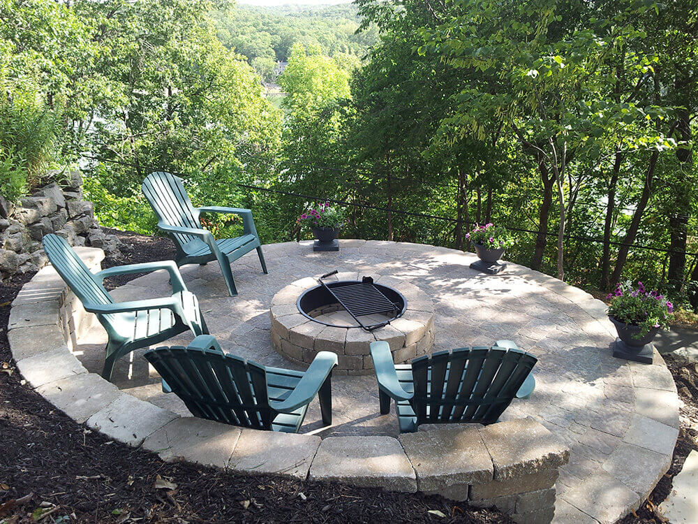 firepit with chairs overlooking trees
