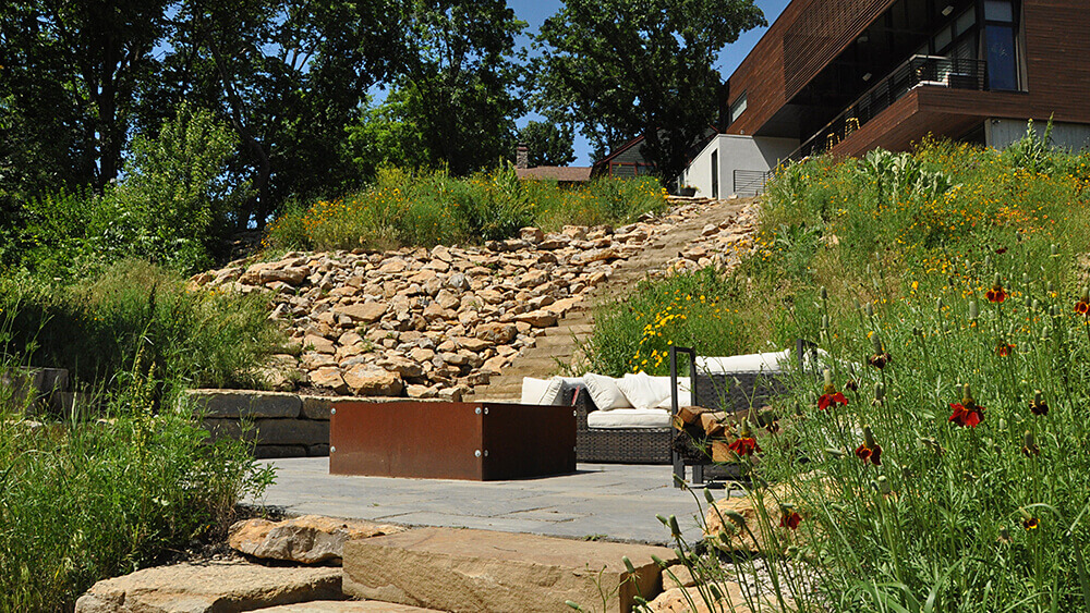 fire pit with seating area and stone wall