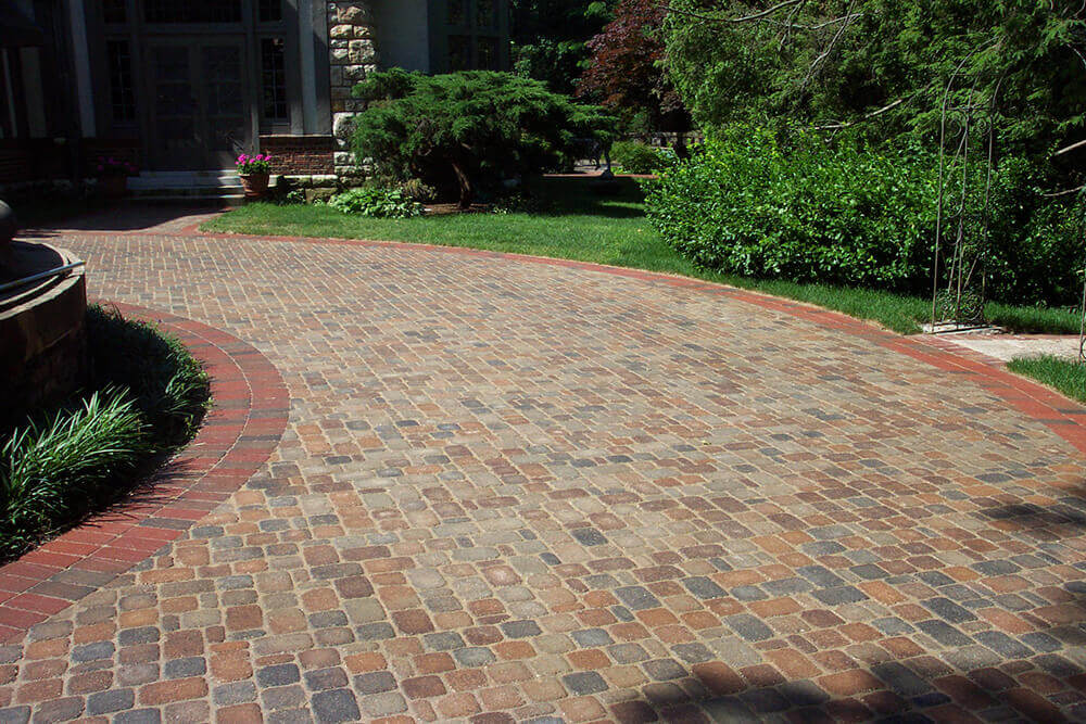 Brick driveway in front of home.