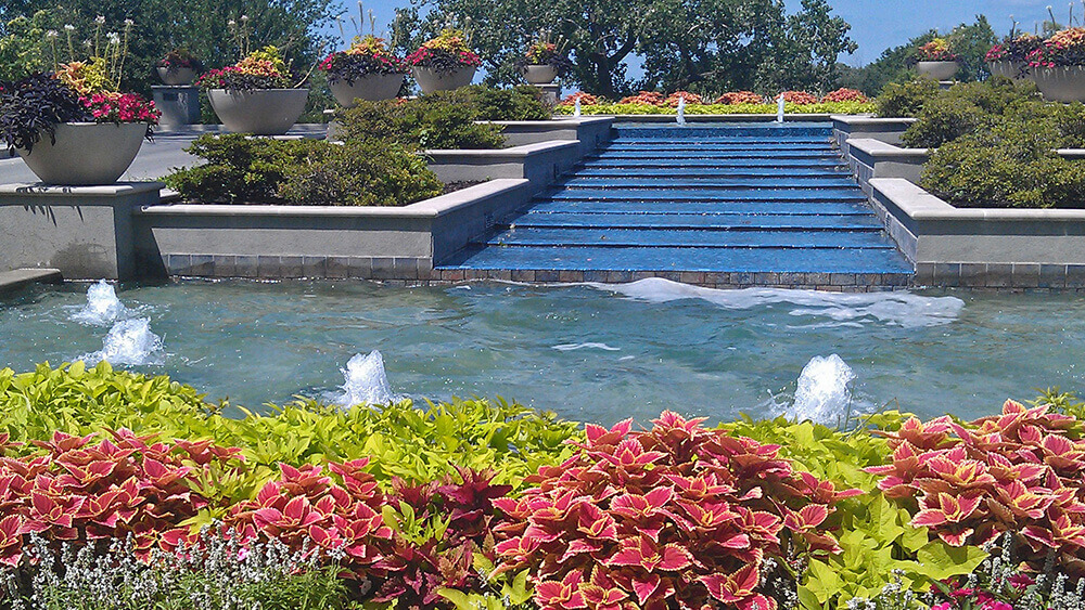 Seasonal landscape for summer with fountain.