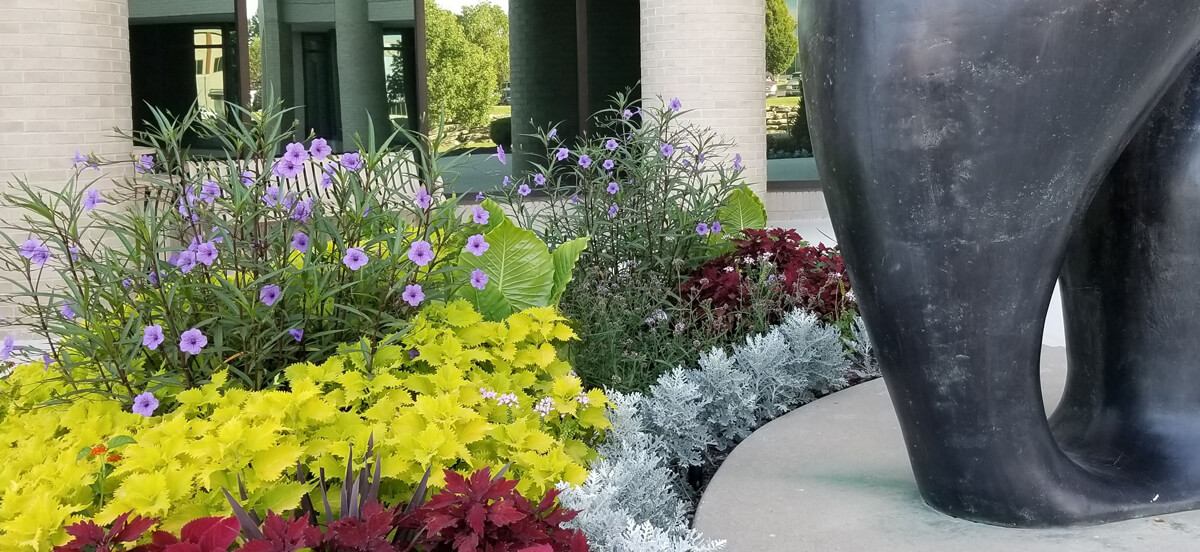 Landscape design with flowers, completed by Embassy Landscape Group.