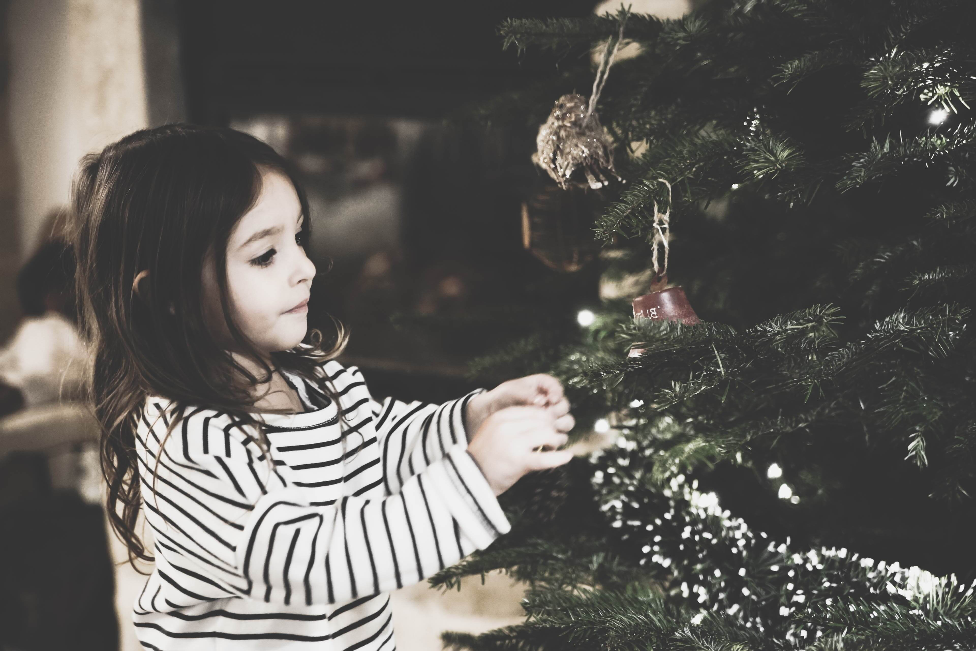 girl hanging ornament